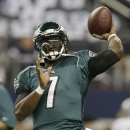 Philadelphia Eagles quarterback Michael Vick (7) tosses a football before an NFL football game against the Dallas Cowboys Sunday, Dec. 29, 2013, in Arlington, Texas. (AP Photo/Tony Gutierrez)