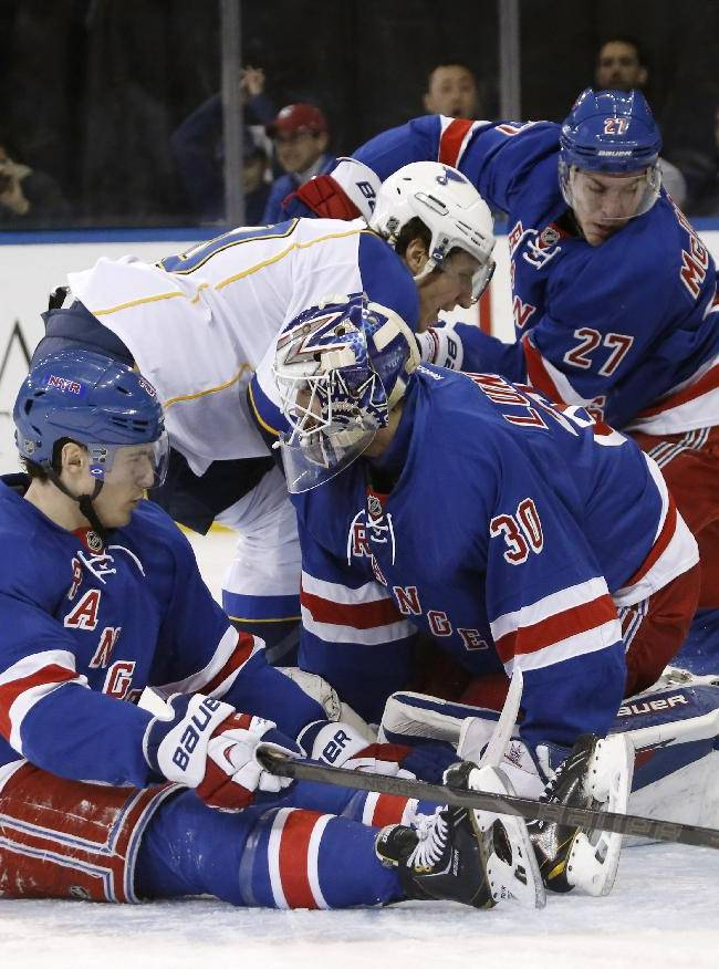 St. Louis Blues center David Backes (42) and New York Rangers defenseman Ryan McDonagh (27) react as a shot by Blues left wing Alexander Steen (20) lodges on the netting behind the goal post for a score during the first period of an NHL hockey game at Madison Square Garden in New York, Thursday, Jan. 23, 2014. Rangers goalie Henrik Lundqvist (30), of Sweden, and left wing Chris Kreider (20) react after Rangers defenseman Ryan McDonagh (27) tried to scoop it out