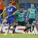 Schalke's Kevin-Prince Boateng, right, fends off Chelsea's Branislav Ivanovic during the Champions League group G soccer match between Chelsea and Schalke 04 at Stamford Bridge stadium in London, Wednesday, Sept. 17, 2014