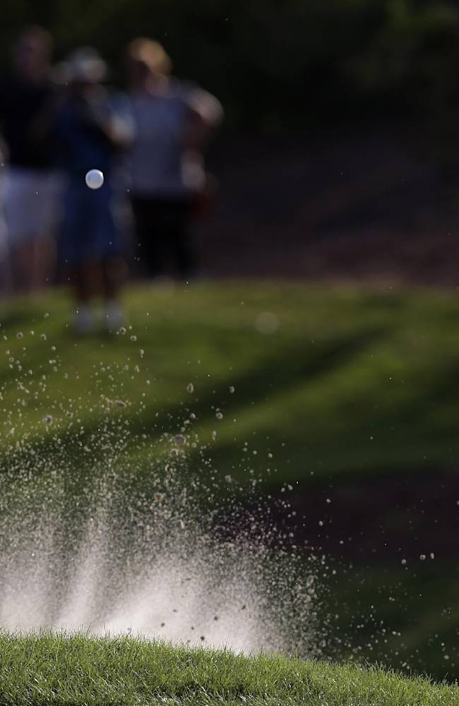 Alejandro Canizares from Spain plays a bunker shot during the 3rd round of the World Tour Golf Championship in Dubai, United Arab Emirates, Saturday, Nov. 16, 2013