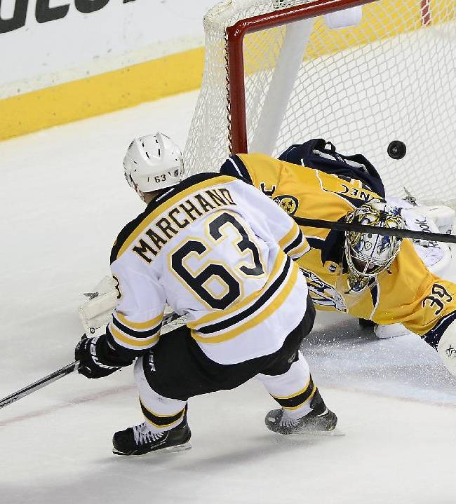 Boston Bruins left wing Brad Marchand (63) shoots the puck past Nashville Predators goalie Marek Mazanec (39), of Czech Republic, for a goal in the third period of an NHL hockey game on Monday, Dec. 23, 2013, in Nashville, Tenn. The Bruins won 6-2