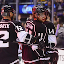 Los Angeles Kings right wing Marian Gaborik (12), of Slovakia, and center Anze Kopitar (11), of Slovenia, celebrate teammate right wing Justin Williams' goal during the second period of an NHL hockey game against the Minnesota Wild, Monday, March 31, 2014