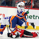 Ottawa Senators' Mark Stone (61) is checked by New York Islanders' Nikolay Kulemin (86) and Thomas Hickey (14) during third-period NHL hockey game action in Ottawa, Ontario, Thursday, Dec. 4, 2014 The Associated Press