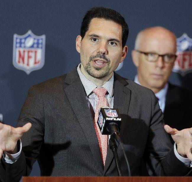 NFL vice president of officiating Dean Blandino speaks during a news conference, while Atlanta Falcons President, CEO and NFL competition committee member Rich McKay, back right, listens, at the NFL football annual meeting in Orlando, Fla., Monday, March 24, 2014