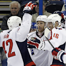Washington Capitals center Brooks Laich (21), center, celebrates his goal against the Tampa Bay Lightning with teammates Joel Ward (42) and Eric Fehr (16) during the second period of an NHL hockey game Tuesday, Dec. 9, 2014, in Tampa, Fla The Associated P