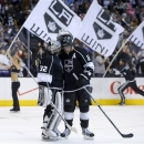 Los Angeles Kings center Anze Kopitar, of Slovenia,, right, celebrates their win with goalie Jonathan Quick in Game 2 of their second-round NHL hockey Stanley Cup playoff series, Thursday, May 16, 2013, in Los Angeles.  (AP Photo/Mark J. Terrill)