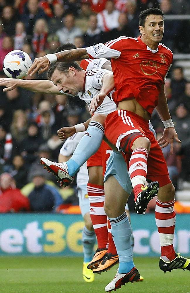 Southampton's Jose Fonte, right, and West Ham's Kevin Nolan vie for the ball during the English Premier League soccer match between Southampton and West Ham United at St Mary's Stadium in Southampton, England Sunday, Sept. 15, 2013