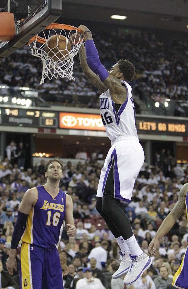 Sacramento Kings guard Ben McLemore, right, stuffs over Los Angeles Lakers Pau Gasol, left, of Spain, during the third18quarter of an NBA basketball game in Sacramento, Calif., Friday, Dec. 6, 2013.   The Lakers won 106-100