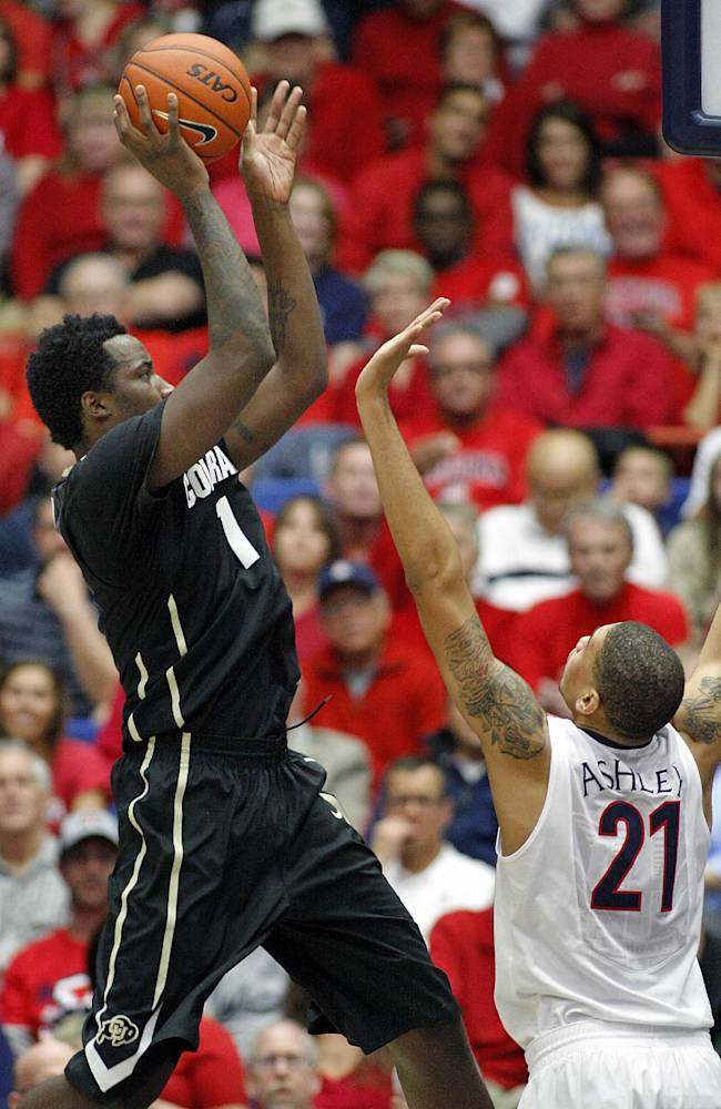 Colorado's Wesley Gordon (1) shoots for two over the arms of Arizona's Brandon Ashley (21) in the first half of an NCAA college basketball game, Thursday, Jan. 23, 2014 in Tucson, Ariz