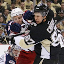 Columbus Blue Jackets' Jack Johnson (7) tries to clear Pittsburgh Penguins' Sidney Crosby (87) from in front of Blue Jackets goalie Sergei Bobrovsky (72) during the second period of a first-round NHL playoff hockey game in Pittsburgh on Wednesday, April 1