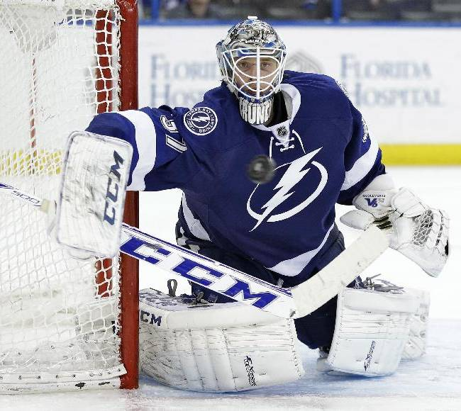 Tampa Bay Lightning goalie Kristers Gudlevskis (37), of Latvia, makes a save on a shot by the Columbus Blue Jackets during the third period of an NHL hockey game Friday, April 11, 2014, in Tampa, Fla. The Lightning won the game 3-2