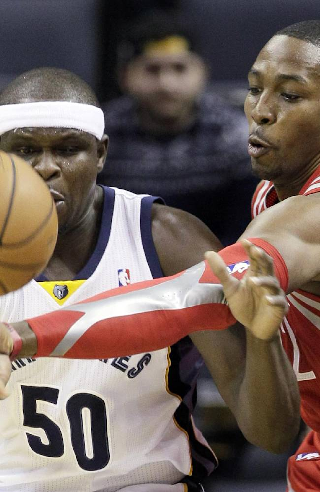 Houston Rockets' Dwight Howard, right, slaps the ball away from Memphis Grizzlies' Zach Randolph (50) during the first half of an NBA preseason basketball game in Memphis, Tenn., Friday, Oct. 25, 2013
