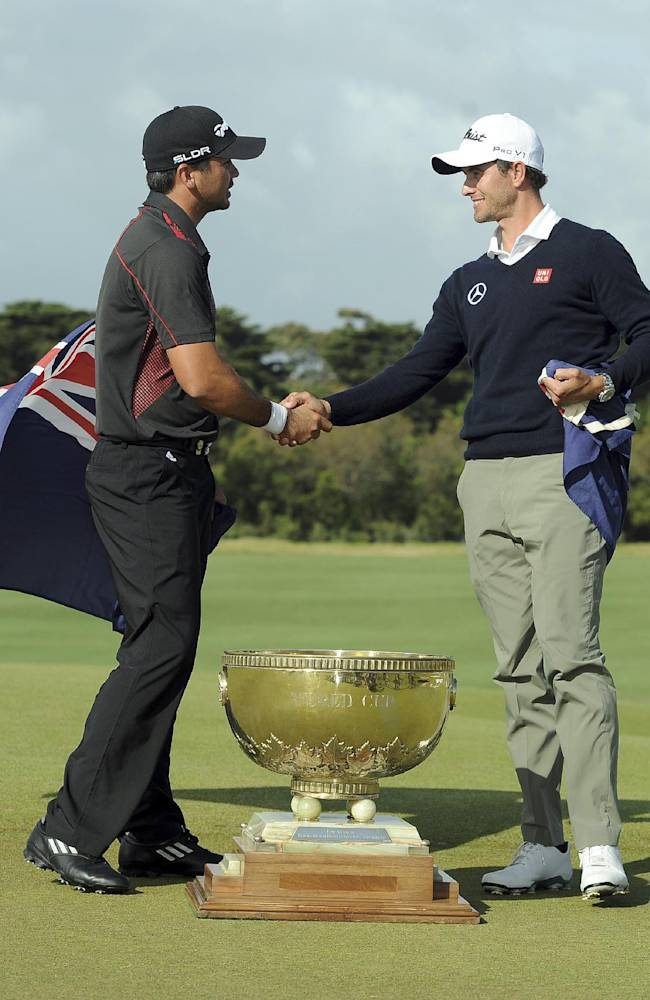 Jason Day, left, of Australia and compatriot Adam Scott congratulate each other after winning the team event at the World Cup of Golf at Royal Melbourne Golf Course in Australia, Sunday, Nov. 24, 2013