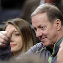 FILE - In this April 4, 2014 file photo, former Buffalo Bills quarterback Jim Kelly gestures during the first half of an NBA basketball game between the New York Knicks and the Washington Wizards, in New York. Kelly established a charitable foundation in honor of a son who died of a rare neurological disorder. Now it's the Hall of Fame quarterback who needs assistance during what's been a yearlong battle with jaw and sinus cancer. (AP Photo/Frank Franklin II, File)