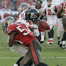 Atlanta Falcons wide receiver Roddy White (84) fumbles as he is sandwiched by Tampa Bay Buccaneers outside linebacker Lavonte David (54) and strong safety Mark Barron (23) during the fourth quarter of an NFL football game Sunday, Nov. 17, 2013, in Tampa,