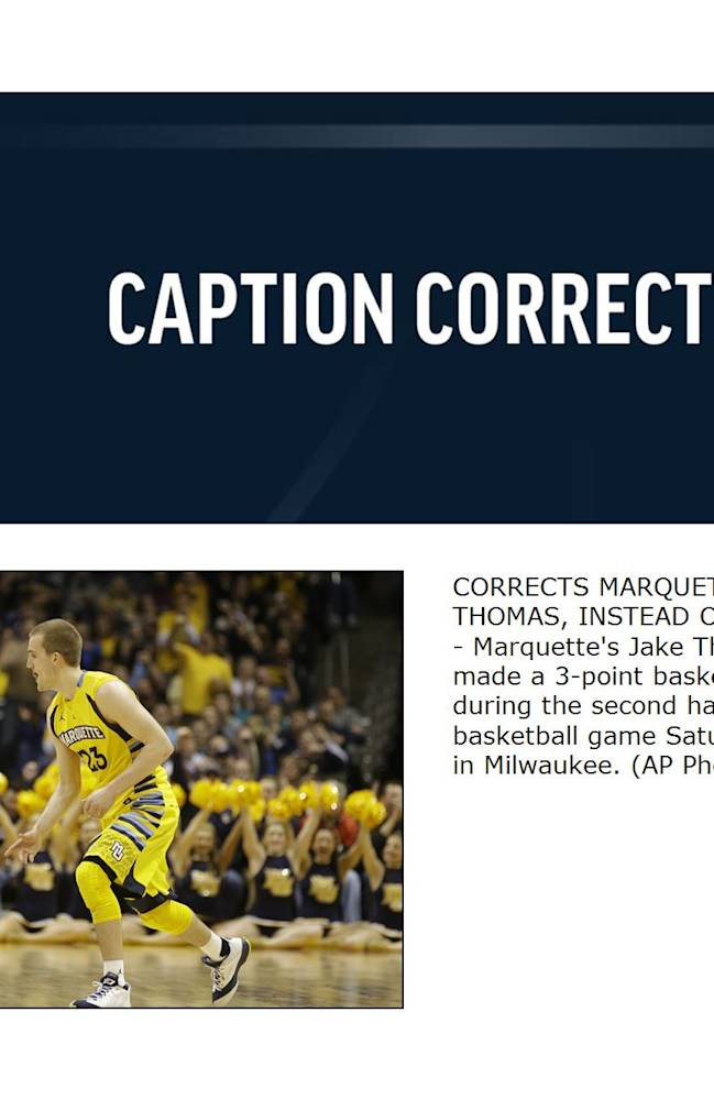 CORRECTS MARQUETTE PLAYER TO JAKE THOMAS, INSTEAD OF STEVE TAYLOR JR. - Marquette's Jake Thomas reacts after he made a 3-point basket against Xavier during the second half of an NCAA college basketball game Saturday, Feb. 15, 2014, in Milwaukee