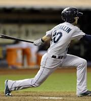 Seattle Mariners' Nick Franklin swings for an RBI single off Oakland Athletics' Sean Doolittle in the eighth inning of an MLB American League baseball game Tuesday, Aug. 20, 2013, in Oakland, Calif. (AP Photo/Ben Margot)