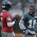 Philadelphia Eagles quarterback Michael Vick, left, meets with wide receiver DeSean Jackson during practice at the NFL football team's training facility, Thursday, Dec. 5, 2013, in Philadelphia The Associated Press