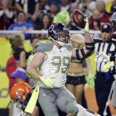 Houston Texans' J.J. Watt (99) holds up the ball after intercepting a pass during the first half of the NFL Football Pro Bowl Sunday, Jan. 25, 2015, in Glendale, Ariz. (AP Photo/Mark Humphrey)