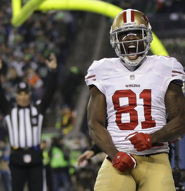 San Francisco 49ers' Anquan Boldin celebrates his touchdown catch during the second half of the NFL football NFC Championship game against the Seattle Seahawks Sunday, Jan. 19, 2014, in Seattle