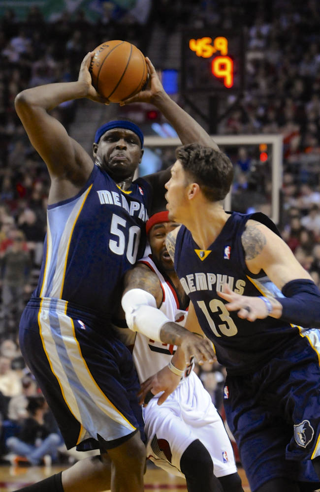 Memphis Grizzlies' Zach Randolph (50) and Mike Miller (13) put the squeeze on Portland Trail Blazers' Mo Williams during the first half of an NBA basketball game in Portland, Ore., Sunday March 30, 2014