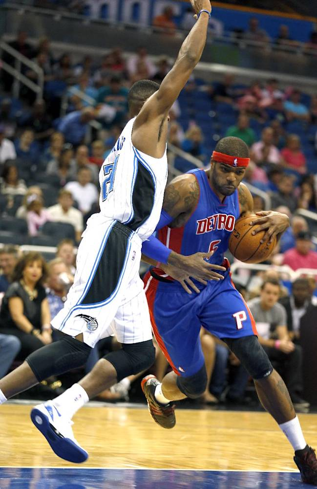 Detroit Pistons forward Josh Smith (6) drives around Orlando Magic forward Maurice Harkless (21) during the first half of an NBA basketball game on Sunday,  Oct.  20, 2013 in Orlando, Fla