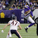 Minnesota Vikings wide receiver Jerome Simpson, right, catches a pass over Chicago Bears free safety Chris Conte during the second half of an NFL football game on Sunday, Dec. 1, 2013, in Minneapolis The Associated Press