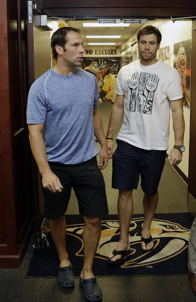 Nashville Predators center David Legwand, left, and defenseman Shea Weber, right, leave the locker room on the first day of NHL hockey training camp Wednesday, Sept. 11, 2013, in Nashville, Tenn. The team will try to bounce back from a rare losing season