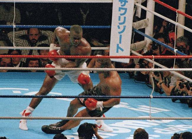 In this Feb. 11, 1990, file photo, James Douglas follows with a left, dropping Mike Tyson to the canvas in the 10th round of scheduled 12-round heavyweight champion bout at the Tokyo Dome in Tokyo. Tyson, the youngest heavyweight champion in boxing history, comes into the bout 37-0 with 33 knockouts, while the unknown Douglas is 29-4-1 with 19 KOs