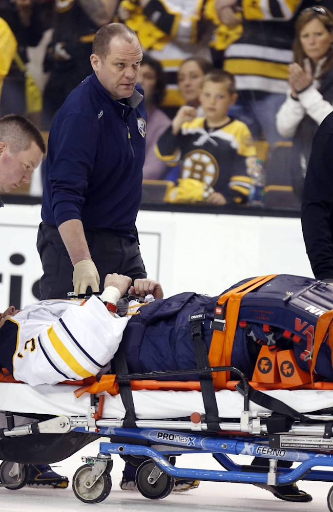 Buffalo Sabres' Matt Hackett (31) is carted off the ice on a stretcher after getting injured in the third period of an NHL hockey game against the Boston Bruins in Boston, Saturday, April 12, 2014. The Bruins won 4-1