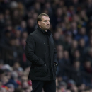 Liverpool's manager Brendan Rodgers watches as his team lose 3-0 during the English Premier League soccer match between Manchester United and Liverpool at Old Trafford Stadium, Manchester, England, Sunday Dec. 14, 2014