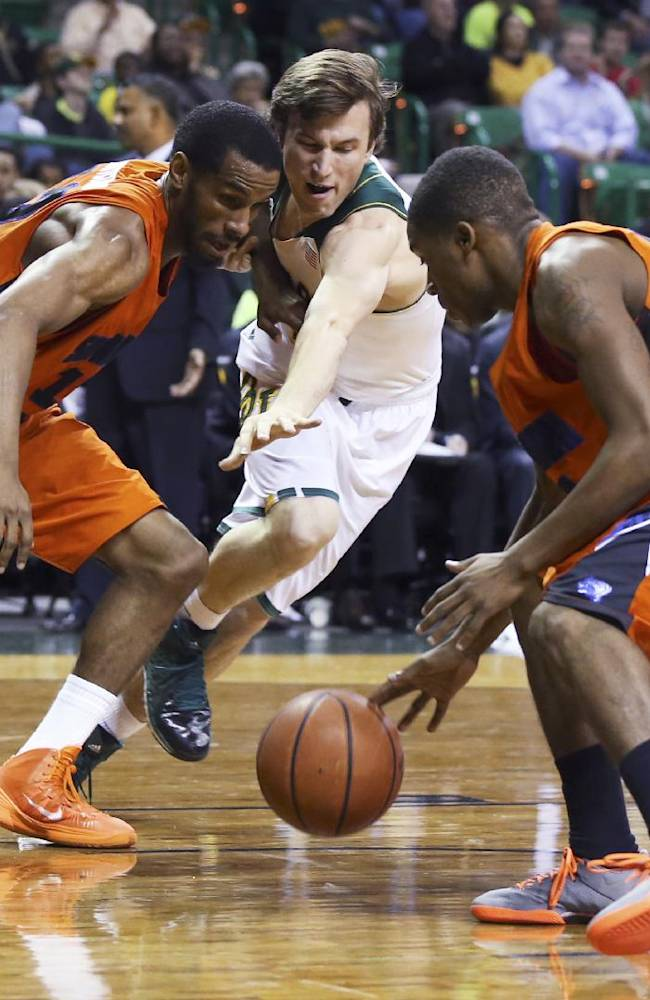 Savannah State forward Joshua Montgomery, left, reaches for a loose ball with Baylor guard Brady Heslip, center, and Savannah State's Terel Hall during the second half of an NCAA college basketball game, Friday, Jan. 3, 2014, in Waco, Texas