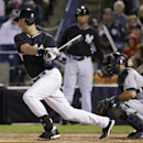 New York Yankees' Derek Jeter hits a third-inning single during a spring training baseball game against the Detroit Tigers in Tampa, Fla., Friday, March 7, 2014 The Associated Press