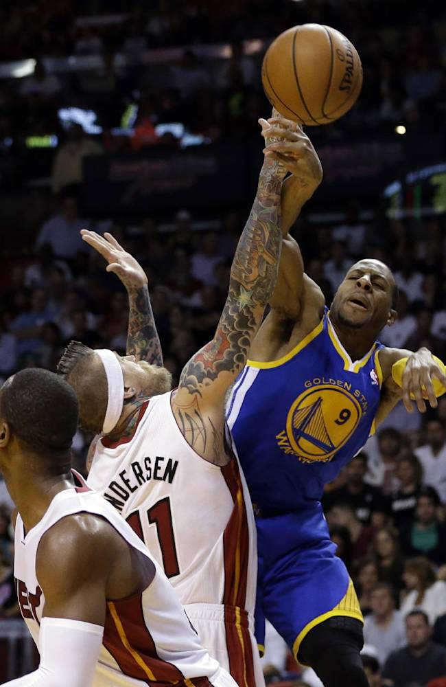 Golden State Warriors' Andre Iguodala (9) passes as Miami Heat's Chris Andersen (11) defends during the second half of an NBA basketball game, Thursday, Jan. 2, 2014, in Miami. The Warriors defeated the Heat 123-114