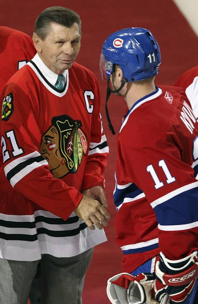 In this Jan. 8, 2008, file photo, Montreal Canadiens captain Saku Koivu (11) talks with Chicago Blackhawks great Stan Mikita during a pregame ceremony in Montreal. Mikita's family says the Blackhawks Hall of Famer has been diagnosed with a suspected brain disorder, adding that the 74-year-old is
