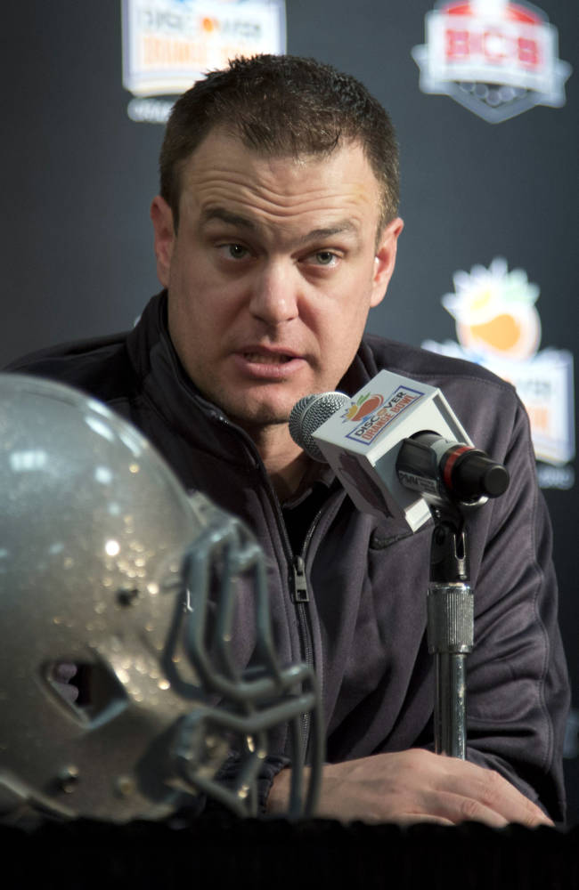 Ohio State offensive coordinator Tom Herman talks to the media during an NCAA college football news conference on Tuesday, Dec. 31, 2013, in Fort Lauderdale, Fla. Ohio State takes on Clemson in the Orange Bowl on Friday, Jan. 3, 2014