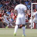 Manchester United's Juan Mata, second from left, scores during the English Premier League soccer match between Bournemouth and Manchester United at Vitality Stadium in Bournemouth, England, Sunday, Aug. 14, 2016. (AP Photo/Frank Augstein)