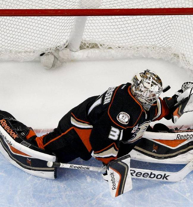 Anaheim Ducks goalie Frederik Andersen fails to block a goal by Los Angeles Kings center Anze Kopitar during the first period of an NHL hockey game in Anaheim, Calif., Thursday, Jan. 23, 2014