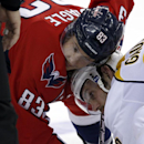 Washington Capitals center Jay Beagle (83) and Nashville Predators center Paul Gaustad (28) battle for position before a face off in the third period of an NHL hockey game, Saturday, Dec. 7, 2013, in Washington. The Capitals won 5-2 The Associated Press