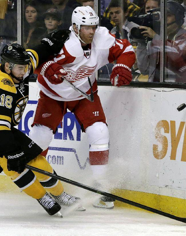 Boston Bruins forward Reilly Smith (18) and Detroit Red Wings forward Daniel Cleary, right,race for the puck during the second period of an NHL hockey game on Saturday, Oct. 5, 2013, in Boston