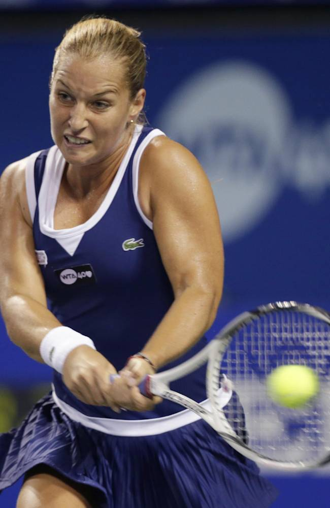 Dominika Cibulkova of Slovakia returns the ball against Agnieszka Radwanska of Poland during their third round match of the Pan Pacific Open tennis tournament in Tokyo, Wednesday, Sept. 25, 2013