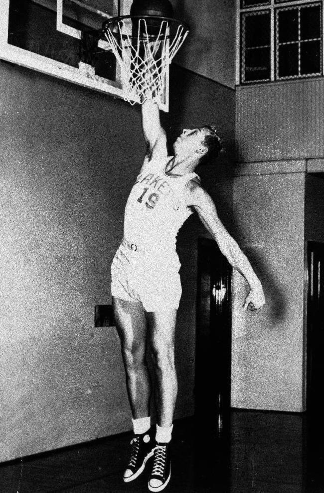In this Jan. 18, 1950, file photo, Minneapolis Lakers' Vern Mikkelsen goes for the basket in Minneapolis. Mikkelsen, a Hall of Fame basketball player who won four NBA titles with the Lakers, has died. He was 85. The Lakers say Mikkelsen died Thursday, Nov. 21, 2013