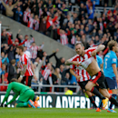 Sunderland's Steven Fletcher, foreground, celebrates scoring his sides second's goal, during the English Premier League match between Sunderland and Stoke City, at the Stadium of Light, in Sunderland, England, Saturday Oct. 4, 2014