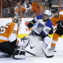 Philadelphia Flyers' Steve Mason, left, blocks a shot by St. Louis Blues' Alexander Steen, center, as Luke Schenn defends during the first period of an NHL hockey game, Saturday, March 22, 2014, in Philadelphia The Associated Press