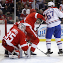 Detroit Red Wings goalie Jimmy Howard (35) can't stop a shot by Montreal Canadiens' David Desharnais as his view is blocked by Montreal Canadiens' Max Pacioretty (67) while Detroit Red Wings' Brendan Smith, center, tries to help defend the goal during the