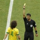 Brazil's David Luiz, left, is booked by referee Ravshan Irmatov from Uzbekistan during the soccer Confederations Cup group A match between Italy and Brazil at Fonte Nova stadium in Salvador, Brazil, Saturday, June 22, 2013. (AP Photo/Natacha Pisarenko)