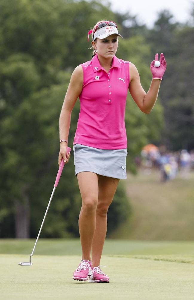 Lexi Thompson acknowledges the gallery on the 18th green during the third round of the Marathon Classic LPGA golf tournament at Highland Meadows Golf Club in Sylvania, Ohio, Saturday, July 19, 2014