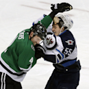 Winnipeg Jets center Mark Scheifele (55) and Dallas Stars defenseman Jason Demers (4) fight during the second period of an NHL hockey game Tuesday, Dec. 9, 2014, in Dallas The Associated Press