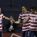 The United States' Landon Donovan (10) congratulates teammate Herculez Gomez, center, after Gomez scored a goal on Guatemala as teammate Joe Corona, right, watches in the first half during an international friendly soccer match Friday, July 5, 2013, in San Diego. (AP Photo/Gregory Bull)