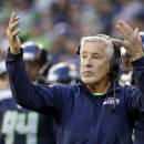 Seattle Seahawks head coach Pete Carroll motions to his team against the Arizona Cardinals in the first half of an NFL football game, Sunday, Nov. 23, 2014, in Seattle. (AP Photo/Elaine Thompson)